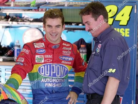 GORDON LOOMIS Jeff Gordon, of Pittsboro, Ind., left, shares a laugh with crew chief Robbie Loomis in the garage at the Talladega Superspeedway Friday afternoon in Talladega, Ala. Drivers will attempt to qualify later this afternoon for Sunday's running of the Winston 500