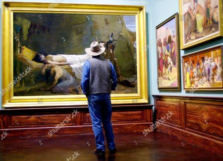 """DEEDS Jim Deeds, of Durango, Colo., takes a long look at """"The Death of Minnehaha"""" by William De Leftwich Dodge at the """"Painter and the American West"""" exhibit in the Denver Museum of Art . The collection, owned by billionaire Philip Anschutz, is on exhibit at the museum through January 2001"""