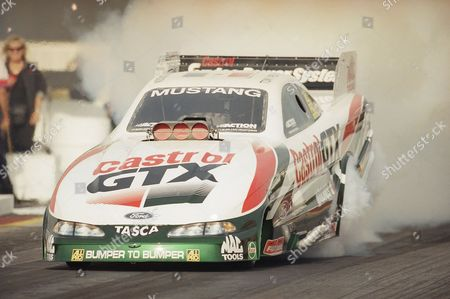 Tony Pedregon of Gardena, Calif., shown here in a semi-final round, defeated his teammate John Force to win the 1997 Winston Finals Funny Car division in Pomona, California on . Pedregon ran a 4.925 at 308.64 mph, taking home the Championship