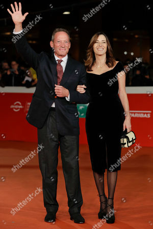 "Cecilia Voll Peck, right, and Anthony Peck pose for photographers as they arrive for the ""Tribute to Gregory Peck"" event, at the Rome Film Festival, in Rome"