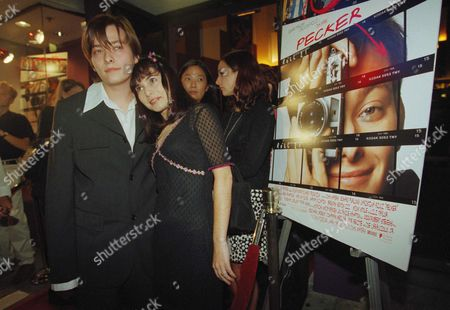 Edward Furlong, Jockie Domac Actor Edward Furlong poses with his girlfriend, Jockie Domac, next to a poster advertising John Waters and Fine Line?s new film, ?Pecker? during the premiere, in Santa Monica. Furlong stars as an amateur photographer who suddenly becomes famous, and co-stars Christina Ricci and Brendan Sexton III