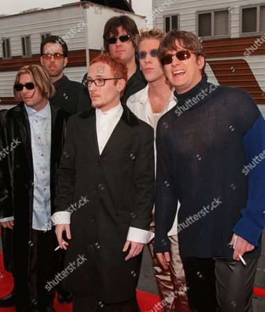 """MATCHBOX 20 New Artist nominee """"matchbox 20"""" arrives for the 25th annual American Music Awards held at the Shrine Auditorium in Los Angeles, . The group has been nominated for Best New Artist. Band members are, Kyle Cook, Paul Doucette, Adam Gaynor, Matthew Serletic, Rob Thomas and Brian Yale. No further identifications available"""