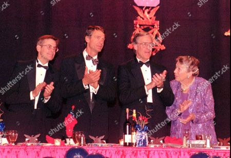 Walton Walmart Members of the Walton family who founded Wal-Mart, from left to right, Jim Walton, John T. Walton, Rob Walton, and mother Helen Walton, applaude as the medal of honor recipients are announced at the Medal of Honors Society Banquet in Little Rock, Ark., . The Walton family was awarded the Patriot award by the Society at the banquet