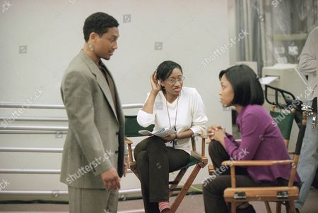 "Diane Wynter, Khalil Kain, Monica Calboun Director Diane Wynter watches her lead actors Khalil Kain, left, and Monica Calboun rehearse a scene for the Black Entertainment Television movie ""Intimate Betrayals,"" during location shooting in Sun Valley section of Los Angeles"
