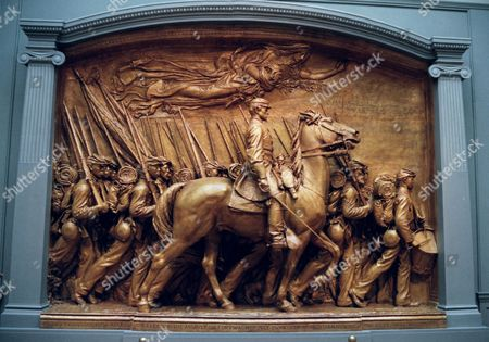 An 18-foot plaster sculpture, painted to look like bronze, a copy of Augustus St. Gaudens' memorial to Col. Robert Gould Shaw and his 54th Massachusetts Regiment, is pictured, at the National Gallery of Art in Washington. The sculpture, the original of which is located in Boston, honors black troops and the white officer who fought and died with them, for the Union and against slavery. The piece goes on official display Sunday Sept. 21 at the gallery