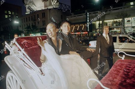 Stock Photo of Brandy, Paolo Montalban Brandy and Paolo Montalban arrive in a horse-drawn carriage at the premiere of ?The Wonderful World of Disney? movie ?Cinderella,? at Mann?s Chinese Theater in the Hollywood section of Los Angeles, . Brandy stars as Cinderella and Montalban plays her prince in the made-for-television production