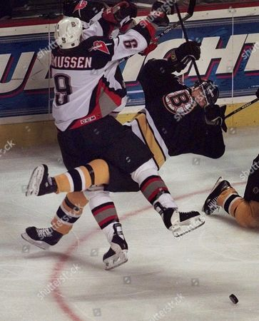 RASMUSSEN HEINZE Buffalo Sabres left wing Erik Rasmussen, left, slams into Boston Bruins right wing Steve Heinze, right, while chasing the puck in the second period in Buffalo, N.Y