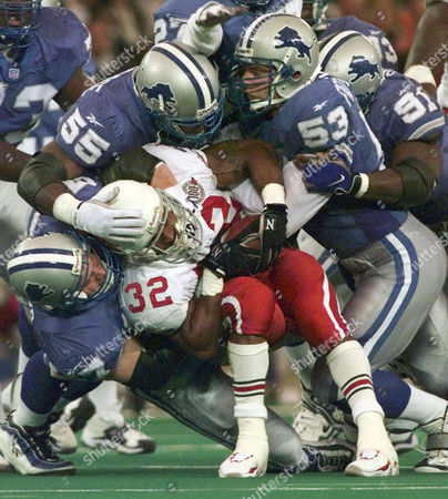 FREDRICKSO Arizona Cardinals running back Michael Pittman (32) is wrapped up by Detroit Lions' Stephen Boyd (57) Allen Aldridge (55), Rob Fredrickson (53) and Robert Porcher (91) for a loss of yardage in the second quarter, in Pontiac, Mich