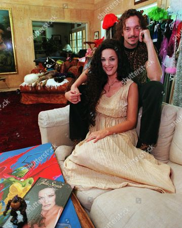 "STRAIN EASTMAN Actress Julie Strain and husband Kevin Eastman sit in their living room in Los Angeles, . Eastman is co-creator of the ""Teenage Mutant Ninja Turtle"" entertainment-and-toy empire. Strain is reigning queen of the straight to video action B-movie circuit, with about 90 films like ""Savage Beach"" behind her"