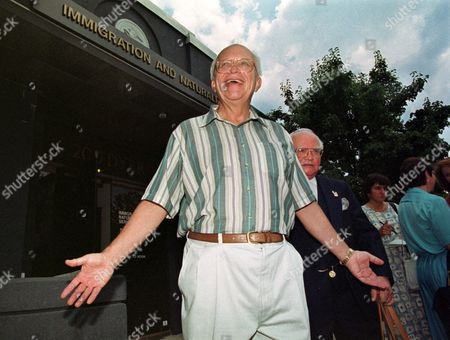 Stock Image of SERGEI KHRUSHCHEV Sergei Khrushchev, son of former Soviet Premier Nikita Khrushchev, smiles outside the Immigration and Naturalization Services building, in Providence, R.I., after completing his American citizenship exam. Sergei answered 19 of the 20 questions correctly and will be sworn in as an American citizen on July 12, 1999