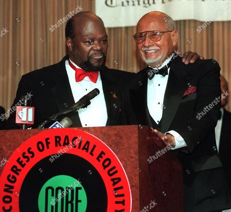 INNIS SUTTON Percy. E. Sutton, right, Founder and Chairman Emeritus of Inner City Broadcasting Corp, smiles as he gets introduced to reporters by Roy Innis, National Chairman of C.O.R.E., at C.O.R.E.'s Dr. Martin Luther King, Jr. Ambassadorial Reception and Awards Dinner in New York. Sutton was presented the Lifetime Achievement Award