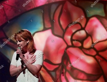 "LOVELESS Country singer Patty Loveless places her hand to her heart while completing her song ""To Have You Back Again"" during a rehearsal for the Academy of Country Music Awards at the Universal Amphitheatre in Universal City, Calif., . The award ceremony is scheduled for April 22, 1998"