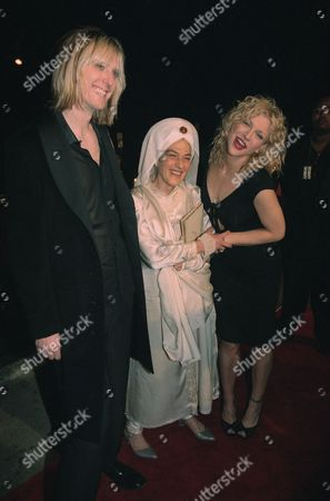 Courtney Love, Gurmukh Kaur Courtney Love, right, and Eric Erlandson, left, of the rock band Hole arrive with Love?s yoga teacher Gurmukh Kaur at the grand re-opening of the Viper Room club in West Hollywood, California, . Hole performed at the event, with all proceeds going to the Center For Living, a Los Angeles-based non-profit organization that teaches yoga and meditation