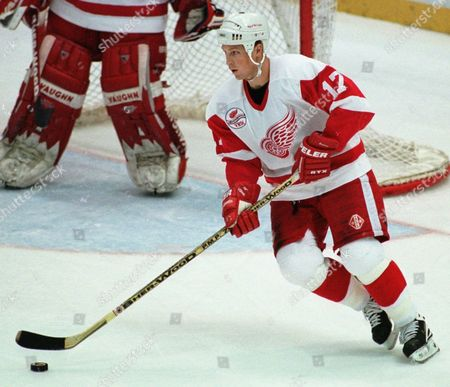 BROWN Detroit Red Wings' Doug Brown carries the puck during the first period against the New Jersey Devils in Detroit on . Brown scored a hat trick for Detroit, which won 5-4