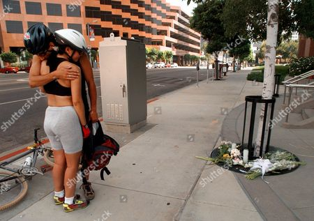 Stock Picture of FINLEY HUAHN Matthew Finley, left, hugs his friend Trellis Huahn after placing a red rose at a impromptu memorial for Princess Diana in front of the British Consulate Sunday morning, in Los Angeles. Finley and Huahn, who live in the Westwood section of Los Angeles, riding their mountain bikes, stopped to place flowers at the memorial