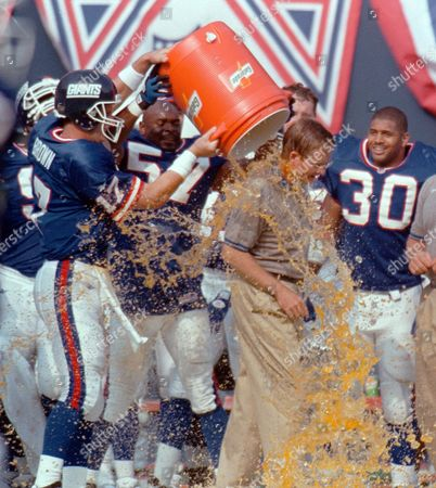 WAY New York Giants head coach Jim Fassel, who turned 48 years-old, has a bucket of Gatorade dumped on him by quarterback Dave Brown in celebration of their 31-17 win over the Philadelphia Eagles at Giants Stadium in East Rutherford N.J. on . Giants Corey Miller (57) and Charles Way (30) watch