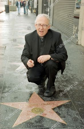 Boys Town USA executive director Father Val Peter visits the Spencer Tracy star on Hollywood?s Walk of Fame on in Los Angeles. Tracy starred in the role of Boys Town founder Father Flanagan in the Oscar-Winning film by the same name. The organization celebrated its 80th anniversary in December