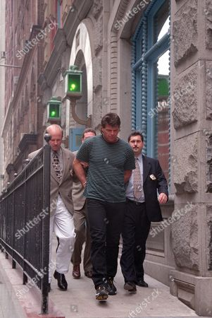 GASTINEAU ARRESTED Former New York Jet Mark Gastineau is escorted out of the stationhouse at the 19th pricinct in New York, . Gastineau was arrested for allegedly assaulting a woman on Aug. 25