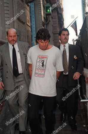 GASTINEAU Former New York Jets lineman Mark Gastineau, center, is walked out of New York's 19th Precinct after surrendering, to face charges of violating a court order to stay away from a woman he is accused of hitting. Gastineau, 41, was charged with criminal contempt for violating an order of protection