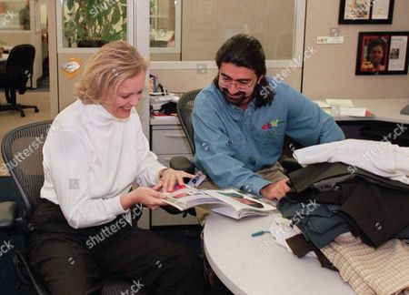Stock Image of Meg Whitman, Pierre Omidyar EBay chief executive officer Meg Whitman, left, and Pierre Omidyar, eBay's chairman of the board, leaf through a magazine at the company's headquarters in San Jose, Calif. The courtroom fight between former pro wrestler Hulk Hogan and news-and-gossip site Gawker is becoming a battleground for Silicon Valley tycoons as well. First Look Media, a news organization financed by Omidyar, philanthropist and the co-founder of eBay, is reaching out to other media outlets to file supportive briefs about Gawker, according to the New York Post. The briefs could be used for the site's appeal of a $140 million invasion-of-privacy verdict Hogan won two months ago because Gawker posted a sex tape of him