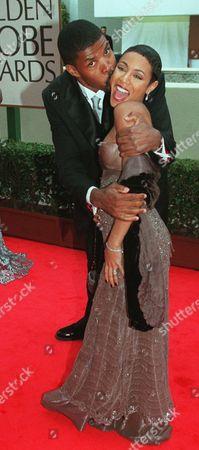 "LASALLE PINKETT E.R."" cast member Eriq LaSalle gives actress Jada Pinkett a kiss on the cheek during arrivals for the 55th Golden Globe Awards, in Beverly Hills, Calif"