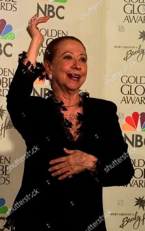 """MONTENEGRO Brazilian actress Fernanda Montenegro gestures backstage after """"Central Station,""""in which she starred, won the Best Foreign Language Film at the Golden Globes in Beverly Hills, Calif"""