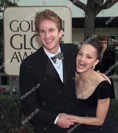 """MATTHEW CARI MODINE Actor Matthew Modine and his wife, Cari, arrive at the 55th Annual Golden Globe Awards in Beverly Hills, Calif., . Modine is nominated for Best Actor in a miniseries or movie made for television for his role in """"What the Deaf Man Heard"""