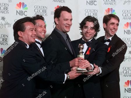 """HANKS Tom Hanks and his production team hold the award for Best Mini-Series or Motion Picture made for Television for their film """"From the Earth to the Moon"""" during the 56th annual Golden Globes in Beverly Hills, Calif., . From left, Tony To, Brian Grazer, Hanks, John Melfi, Michael Bostick"""