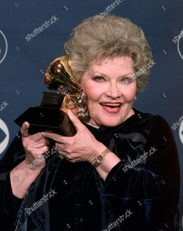 PAGE Patti Page holds up her award for best traditional pop vocal performance during the 41st Annual Grammy Awards at the Shrine Auditorium in Los Angeles