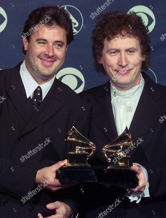 """Stock Image of SCRUGGS GILL Vince Gill, left, and Randy Scruggs pose with their Grammy for Best Country Instrumental Performance backstage at the 41st Annual Grammy Awards at the Shrine Auditorium in Los Angeles . The duo won for """"A Soldier's Joy"""