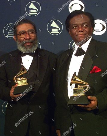 HOLLAND DOZIER Songwriter/producers Brian Holland, left, and Lamont Dozier pose with their special Trustee awards at New York's Radio City Music Hall, during the 40th Annual Grammy Awards. Trustee awards are given to non-performers whose contributions are of such a broad scope that they do not fall into the usual Grammy awards categories