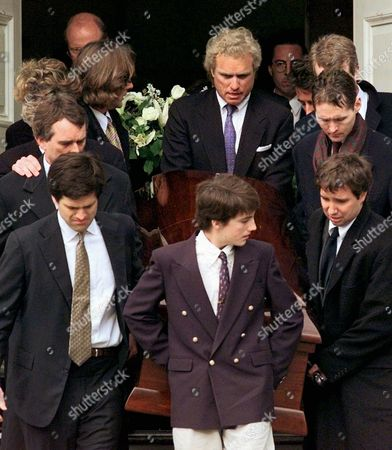 KENNEDY SMITH U.S. Rep. Joe Kennedy, top center, helps carry the casket of his brother Michael Kennedy after his funeral mass at Our Lady of Victory church in Centerville, Mass., . Michael's son, Michael Jr., center front, leads the procession with the help of Timothy Shriver, cousin of Michael Kennedy, lower left, and his uncles Robert Kennedy Jr., upper left, Stephen Kennedy Smith, upper right, and Douglas Kennedy, lower right