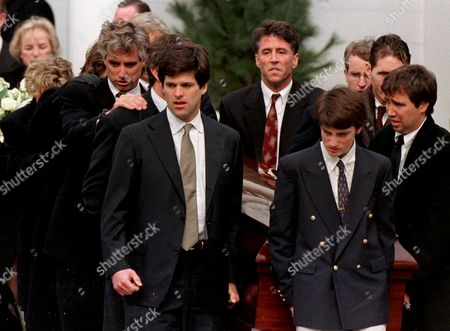KENNEDY SMITH LAWFORD Matthew Kennedy, a brother of Michael Kennedy, places his hand on a fellow pallbearer as Michael Kennedy, Jr. leads the casket of his father out of Our Lady of Victory Church in Centerville, Mass., . Also seen are Timothy Shriver, front left, Chris Kennedy Lawford, back center, and Douglas Kennedy, right, another brother of Michael Kennedy