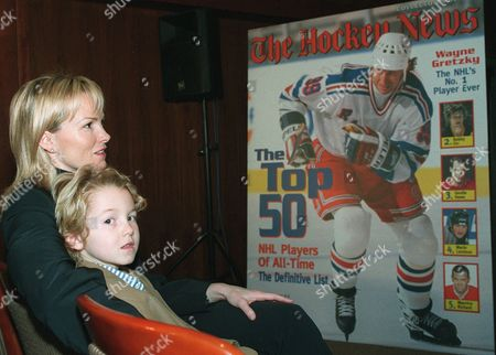 GRETZKY Janet Gretzky, wife of New York Rangers center Wayne Gretzky, and their son, Ty, listen to an announcement, in New York, by The Hockey News naming Wayne Gretzky the number-one hockey player ever in a vote of 50 hockey experts assembled by the magazine