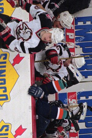 RASMUSSEN SACCO Buffalo Sabres center Erik Rasmussen, left, skates away after checking New York Islanders winger Joe Sacco into the Sabres bench during the first period of their game at the Marine Midland Arena in Buffalo, N.Y. The Islandes beat the Sabres 4-2