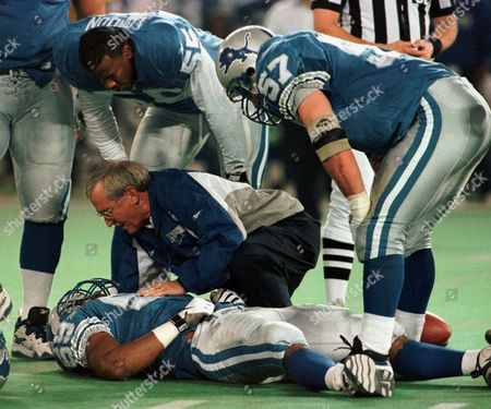 LONDON BROWN BOYD Detroit Lions' Reggie Brown is attended by a trainer as Detroit's Antonio London (55) and Stephen Boyd (57) look on in the fourth quarter of their game against the New York Jets, in Pontiac, Mich