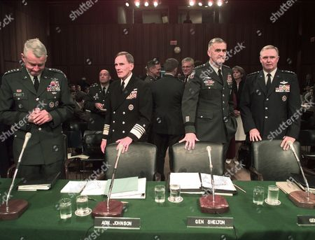JOINT CHIEFS The armed services joint chiefs wait for the start of the Senate Armed Services Committee, Tuesday Sept. 29,1998 in Washington. Left to right; Army Gen. Dennis J. Reimer., Navy Admiral Jay L. Johnson., Chairman of the Joint Chiefs of Staff, Gen. Henry H. Shelton, and Gen. Michael E. Ryan USAF