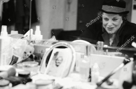 Actress Kaye Ballard poses in her dressing room at New York?s John Houseman Theater, where she plays a loving grandmother in Joe DiPietro?s warmly sentimental comedy ?Over The River and Through the Woods.? A portrait of Ballard?s grandmother sits on the counter in front of her. Ballard is best known as a comedian and for her role as Kaye Buell in the 1960s television series ?The Mothers-In-Law