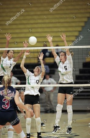 Leah Karratti, Jennifer Roberts Hawaii?s Leah Karratti (2), left, Jennifer Roberts (12), center, and Jessica Sudduth (5), go for the ball during the NCAA championships, in Long Beach, California. Jeannette Hecker (3) of Loyola Marymount is in foreground