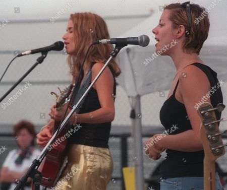 MCLACHLAN NOVA Sarah McLachlan, right, joins Heather Nova for the last song of Nova's set during Lilith '98 at Jones Beach, New York . The second annual Lilith Fair, a nation wide all-women summer music tour, is named for Adam's first wife, before the creation of Eve, according to medieval Jewish folklore