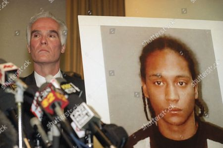 Gil Garcett Los Angeles County District Attorney Gil Garcetti stands beside a photograph of murder suspect Lamont Santos, as Santa Monica Police Chief James T. Butts, Jr., not pictured, speaks during a news conference in Santa Monica, Calif., . Police officials discussed developments, including the recent arrest of Santos, in the Oct. 12 slaying of a German tourist. Two women, in the October 12 slaying of a German tourist. Two women were arrested more than a month ago in the case. While detectives are still looking a fourth suspect