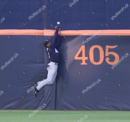GRIFFEY Seattle Mariners' center fielder Ken Griffey Jr. leaps at the fence but has the ball, hit by San Diego Padres' Jim Leyritz, bounce off his glove for a home run in the second inning in San Diego