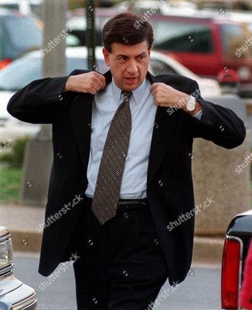 MARV ALBERT Sportscaster Marv Albert puts on his coat as he arrives at the Arlington County Court House, in Arlington, Va., to face sentencing on charges of assault and battery. Albert did not receive a jail term for his conviction, which will be dropped if he stays out of trouble for a year