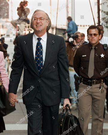 """BLACK Marv Albert's attorney Roy Black arrives at court in Arlington, Va. for Albert's sexual assault trial. When the cross-examination phase of Albert's accuser began Tuesday afternoon, jurors heard a tape recording in which the woman is heard telling a pontential witness, """"You know what to say"""