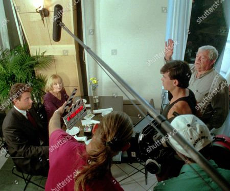 """Veteran movie maker Menahem Golan, right, motions for action during filming of """"The Versace Murder"""" on location in Ft. Lauderdale, Fla. Golan, a veteran Israeli filmmaker who produced some of the biggest action movies of the 1980s, has died in Tel Aviv. He was 85"""