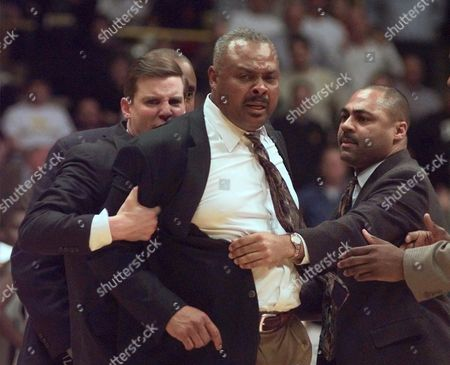 HASKINS JONES BROWN Minnesota head basketball coach Clem Haskins, center, is restrained by assistant coaches Bill Brown, left, and Bobby Jones in the first half against Iowa in Iowa City, . Haskins ran onto the floor to voice his displeasure with the officials during the Iowa-Minnesota basketball game and was assessed a technical foul