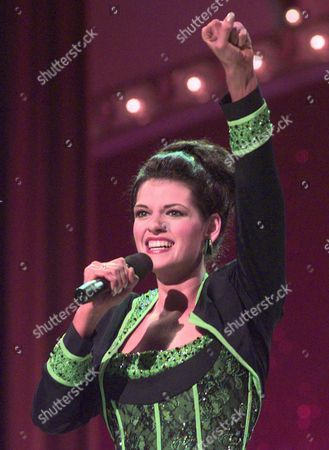 Stock Photo of MISS AMERICA TALENT Miss Illinois Katherine Shindle finishes her talent solo, Don't Rain On My Parade, during the final talent competition of The Miss America Pageant at the Atlantic City Convention Hall . Shindle later was crowned Miss America 1998