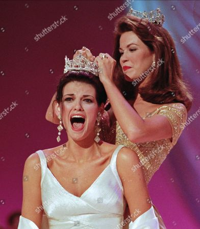 SHINDLE HOLLAND Miss Ilinois Katherine Shindle, left, reacts as she's crowned the 1998 Miss America by the 1997 Miss America Tara Holland at the Miss America Pageant in Atlantic City, N.J