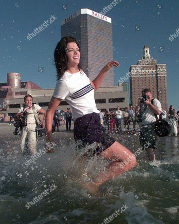 SHINDLE Miss America Katherine Shindle runs past and for photoghraphers in the Atlantic Ocean during the traditional morning on the beach in Atlantic City, N.J