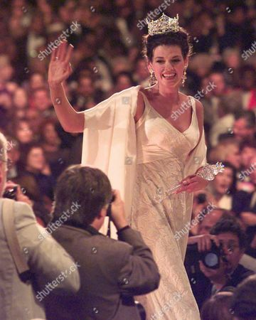 Stock Image of RUNWAY Miss America Katherine Shindle waves to photographers as she walks the runway at the Miss America Pageant in Atlantic City, N.J., Convention Hall